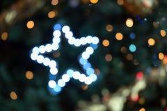 Bokeh bleu et blanc avec l'étoile Photographie stock libre de droits