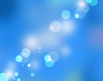 Bokeh blue. Blue and white bright circles on a beautiful blue background Stock Images