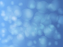 Bokeh on blue Stock Images