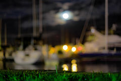 Bokeh blurred boats in the evening royalty free stock image