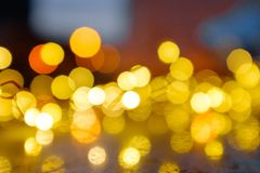 Christmas lights. Bokeh. Blurred lights against the sky stock photography