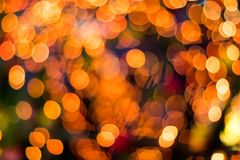 Bokeh blurred lights orange round lot. Stock Images