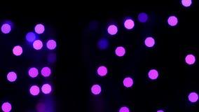 Bokeh borroso colorido del fondo del extracto de la luz Cámara lenta almacen de metraje de vídeo