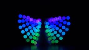 Bokeh borroso colorido del fondo del extracto de la luz que se mueve alrededor Cámara lenta metrajes
