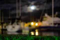 Bokeh borrou barcos na noite Imagem de Stock Royalty Free