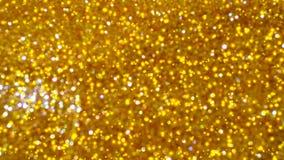 Bokeh brilhante dourado do sumário no fundo matizado claro Fundo de incandescência com estilo do bokeh para cumprimentos sazonais fotografia de stock royalty free