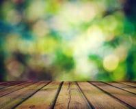 Bokeh brillante y suelo de madera Fotografía de archivo