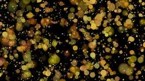 Bokeh, círculos de oro en fondo negro Imágenes de archivo libres de regalías