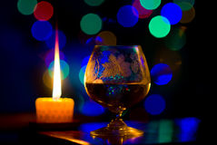 Bokeh with candle and glass Royalty Free Stock Photo