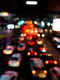 Bokeh of car light in traffic jam on the road. In the night Stock Photography