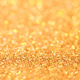 Bokeh. Christmas gold blinking background Stock Image