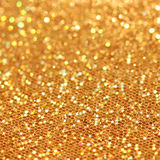 Bokeh. Christmas gold blinking background Stock Photos