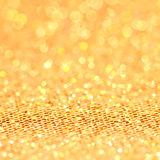 Bokeh. Christmas gold blinking background Stock Images