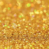 Bokeh. Christmas goldan blinking background Royalty Free Stock Image