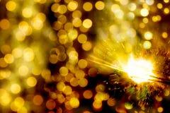 Bokeh christmas lights and sparkler Stock Image