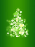 Bokeh christmas tree. A christmas tree with bokeh effect and green background Royalty Free Stock Photography