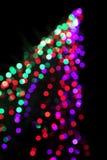 Bokeh of a christmas tree. Colorful lights abstract, christmas tree shape Royalty Free Stock Images