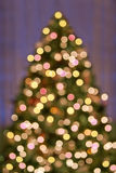 Bokeh Christmas Tree lights. Background pattern - an out of focus lighted Christmas tree Royalty Free Stock Photo
