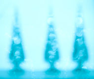 Bokeh christmas trees. Abstract background of bokeh christmas trees in blue Stock Photos
