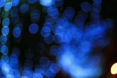 Bokeh. The circular blue light bokeh on dark blackground Stock Images