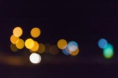 Bokeh claro colorido do brilho e do fulgor na noite Imagens de Stock Royalty Free