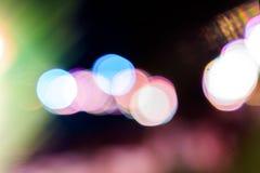Bokeh claro colorido na noite Imagens de Stock