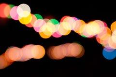 Bokeh claro colorido na noite Fotografia de Stock Royalty Free