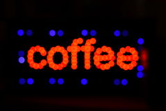Bokeh coffee light letters Royalty Free Stock Images