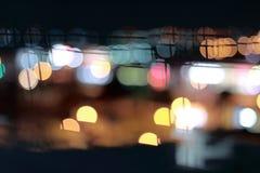 Bokeh coloré abstrait sur le fond de nuit photographie stock libre de droits