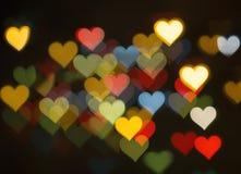Bokeh coloré de coeur Photos stock