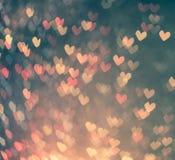 Bokeh coloré de coeurs comme fond Image stock