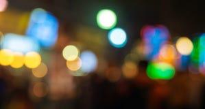Bokeh coloré entoure pour le fond, Defocused léger de scintillement Photos stock