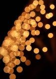 Bokeh coloré brouillé de cercles des lumières de Noël Image libre de droits