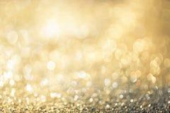 Bokeh Colorfull золота яркого блеска запачкало абстрактную предпосылку для bir
