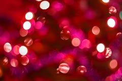 Bokeh colorido borrado dos círculos de luzes de Natal Foto de Stock Royalty Free