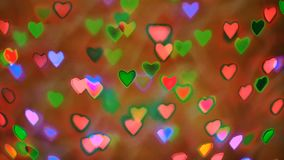Bokeh colorido das festões piscar na forma do coração usada como o fundo para o dia de Valentim, efeito de néon video estoque