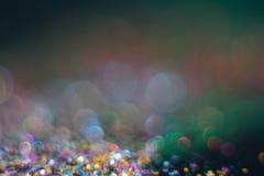 Bokeh colorido de la abstracción en un fondo oscuro defocused fotografía de archivo libre de regalías