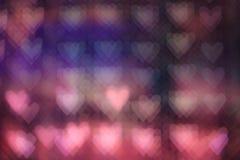 Bokeh colorido de la luz del corazón Fotos de archivo