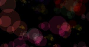 Bokeh colorido de las partículas de la Navidad abstracta que fluye en el fondo negro, Navidad del día de fiesta festiva almacen de metraje de vídeo