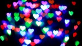 Bokeh colorido de los corazones, fondo abstracto almacen de video