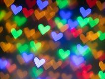 Bokeh colorido de los corazones para el fondo fotos de archivo