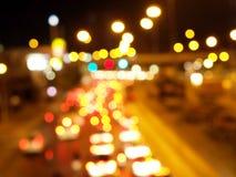 Bokeh colorido Defocused de las luces del coche y de la lámpara de calle Foto de archivo libre de regalías