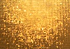 Bokeh d'or abstrait de lumières pour le fond photographie stock libre de droits