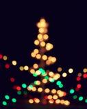 Bokeh da decoração das luzes do Feliz Natal Foto de Stock
