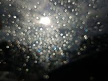 Bokeh da luz solar no dia nebuloso Foto de Stock