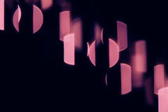 Bokeh dark pink circles and stripes on black background. Royalty Free Stock Photography