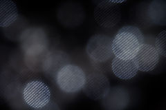 Bokeh dark white mesh circles on black background. Abstract music background Stock Photos