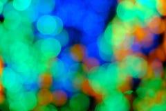 Bokeh de la lumière de nuit de couleur, fond brouillé Photos stock