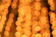 Bokeh de la luz ámbar Fotos de archivo libres de regalías