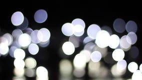 Bokeh de las luces blancas del centelleo metrajes